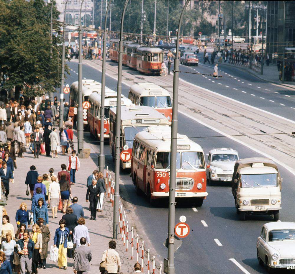 """A photograph from the album """"Warszawskie autobusy. Najpiękniejsze fotografie""""  Jelcz and Berliet buses on Marszałkowska street 1970s, photo: Zbyszko Siemaszko / Forum"""
