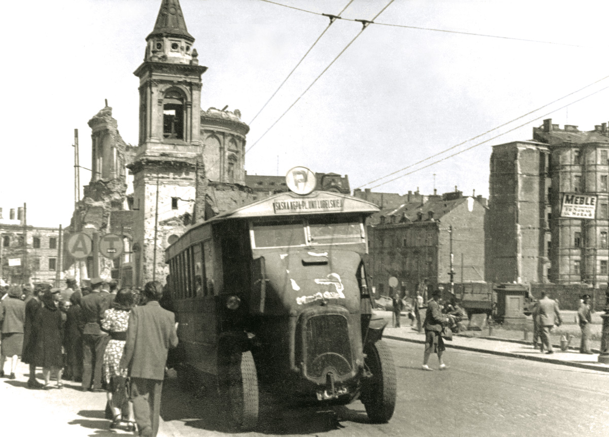 """A photograph from the album """"Warszawskie autobusy. Najpiękniejsze fotografie"""". In the photograph, a Somua bus fixed with the efforts of  MZK employees, on the Trzech Krzyży square, spring, 1946, from the collection of the Warsaw Museum, photo: courtesy of Wydawnictwo RM"""