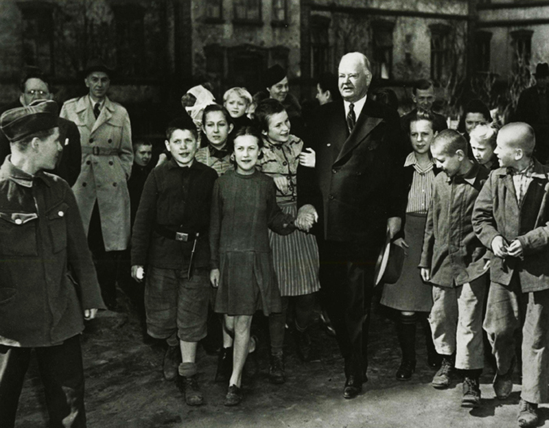 Herbert Hoover visits children's schools and orphanages in Warsaw, Poland, March 30, 1946. Hoover (Herbert) subject collection, Hoover Institution Archives, envelope SSS, photo from the Archive Hoover Institution