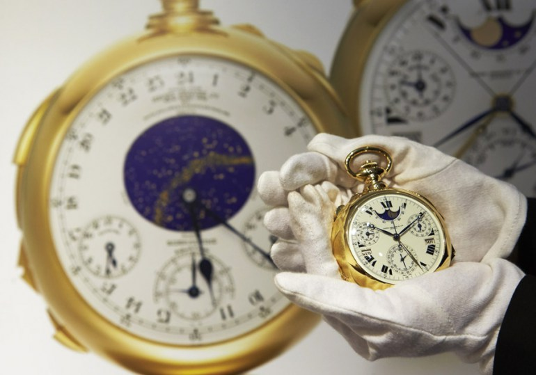 "A staff member holds ""The Henry Graves Supercomplication"" handmade watch by Patek Philippe at Sotheby's auction house in Geneva in this November 5, 2014 file photo.  A gold pocket watch made by Patek Philippe for a New York banker in the early 1930s fetched 23.2 million Swiss francs ($24 million) at auction on Tuesday, smashing the record for a timepiece it set 15 years ago, Sotheby's said. Henry Graves commissioned the famed Swiss watchmaker to produce the world's most complicated watch and surpass one made for James Packard, the American automobile manufacturer. Picture taken November 5, 2014,  photo: /Denis Balibouse / REUTERS / Forum"