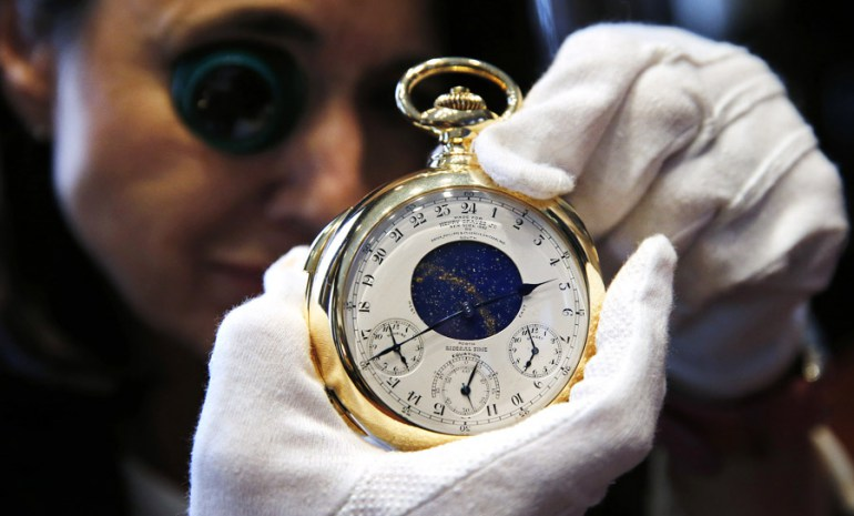 "Chairman of Sotheby's Watch Division Daryn Schnipper poses with ""The Henry Graves Supercomplication"" handmade watch by Patek Philippe which was completed in 1932 at Sotheby's auction house in London October 21, 2014. This masterpiece of horology is estimated to sell in excess of close to 10 million pounds when it is auctioned on November 11 in Geneva. photo: Suzanne Plunkett / REUTERS  / Forum"