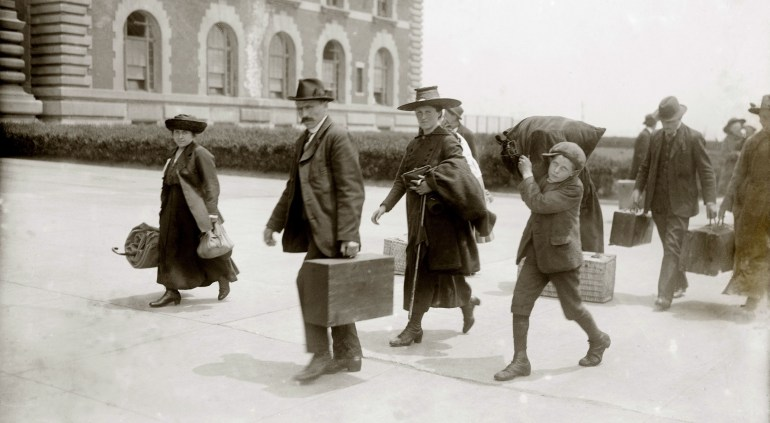 European immigrants arriving at Ellis Island, ca. 1920, some of the last to enter after World War I, when the United States set national quotas greatly reducing immigration. Photo: Everett Collection / Forum