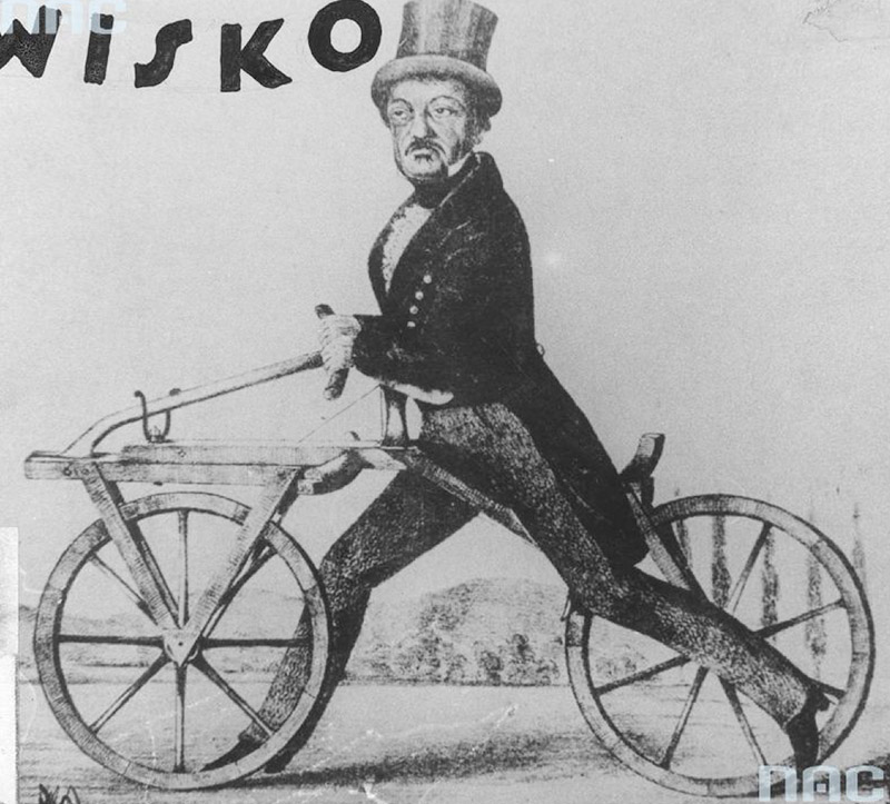 Karl Friedrich Drais von Sauerbronn on the first bicycle of his own construction, powered by pushing legs off the ground. In the upper left corner, the inscription reads 'Wisko'. A photocopy of a drawing, photo: www.audiovis.nac.gov.pl / NAC