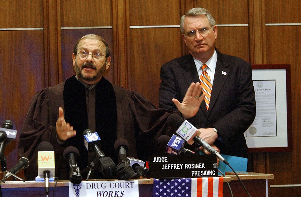 Miami State Drug Court Judge Jeffrey Rosinek, left, and John P. Walters, Director of National Drug Control Policy, during a news conference, 2005, photo: Pat Carter / AP