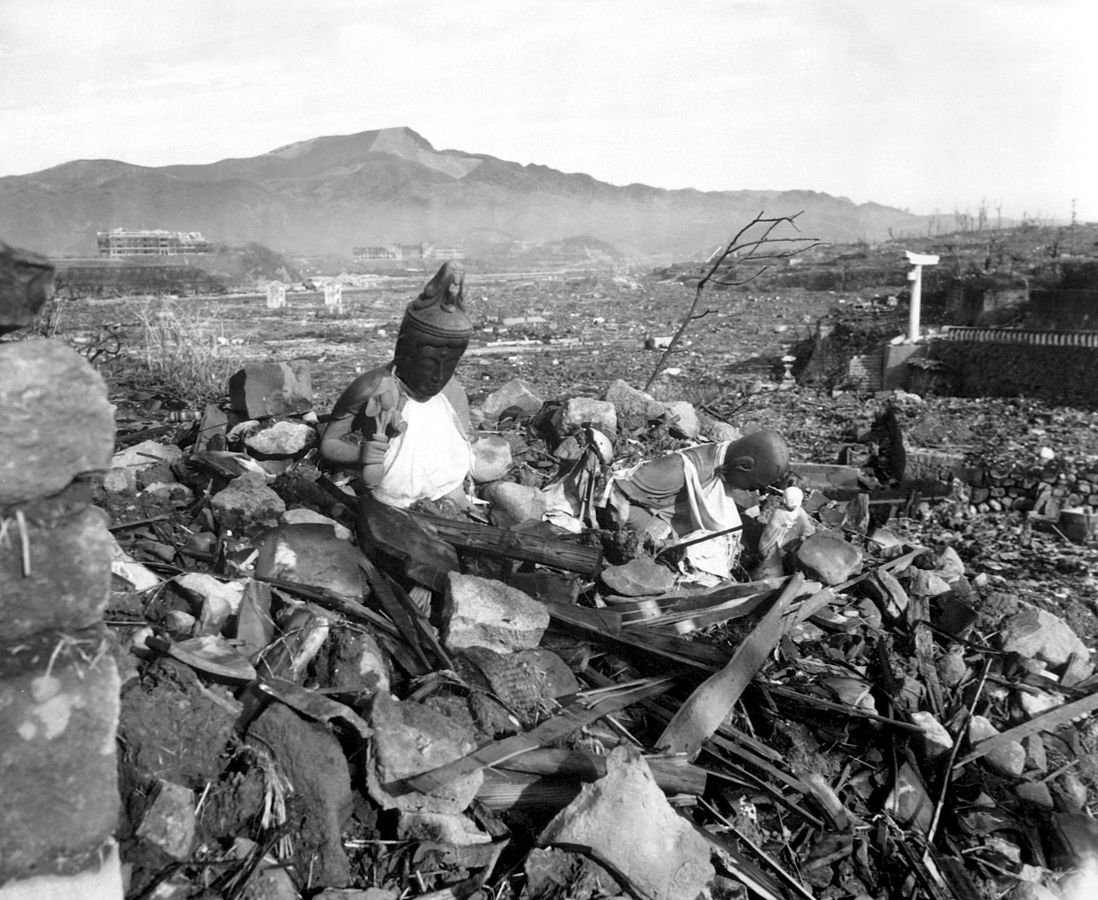 Battered religious figures stand watch on a hill above a tattered valley. Nagasaki, Japan. September 24, 1945, 6 weeks after the city was destroyed by the world's second atomic bomb attack, photo: Wikipedia
