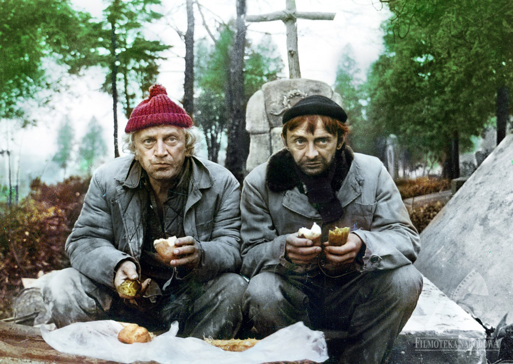"Two gravediggers eating their lunch at cementary. Still from Fucha by Michał Dudzikiewicz. Photo: ""Kadr"" Film Studio / The National Film Archive / www.fototeka.fn.org.pl"