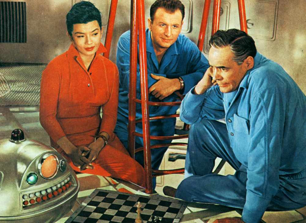 Still from the 1960 movie First Spaceship on Venus directed by Kurt Maetzig. Pictured: Yoko Tani, Gunther Simon and Oldrich Lukes; photo: OKO Film Studio / National Film Archive / www.fonoteka.fn.org.pl
