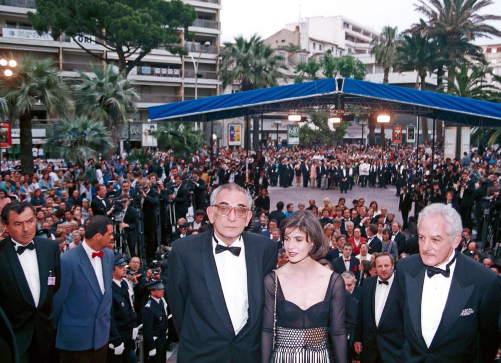 """Krzysztof Kieślowski, Irene Jacob and Marin Karmitz at the premiere of """"Three Colours: Red"""", Cannes Film Festival, 1994, Photo: Jerzy Kośnik , Forum"""