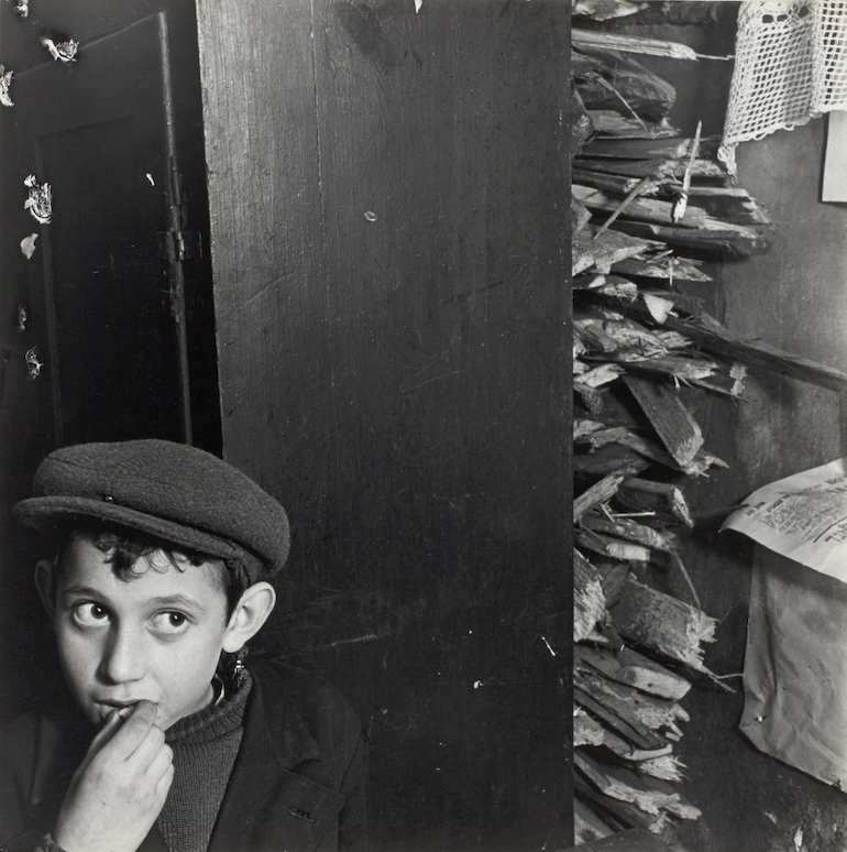 Modernist composition vs traditional jewish life boy with kindling in a basement dwelling
