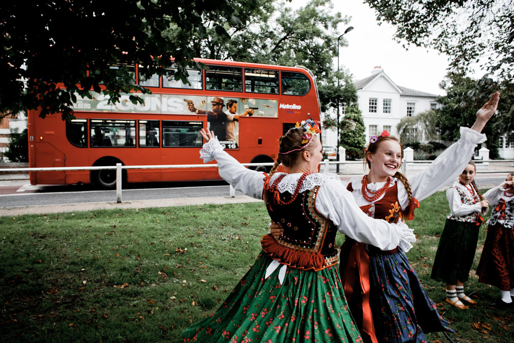 Olga Sawicka and Marta Tatol, members of a Polish immigrant folk group dressed in traditional Cracovian clothes rehearsing before their show during a Polish day organized by Goniec, a Polish immigrant newspaper in Ealing (London). Photo: Piotr Małecki / Napo Images / Forum
