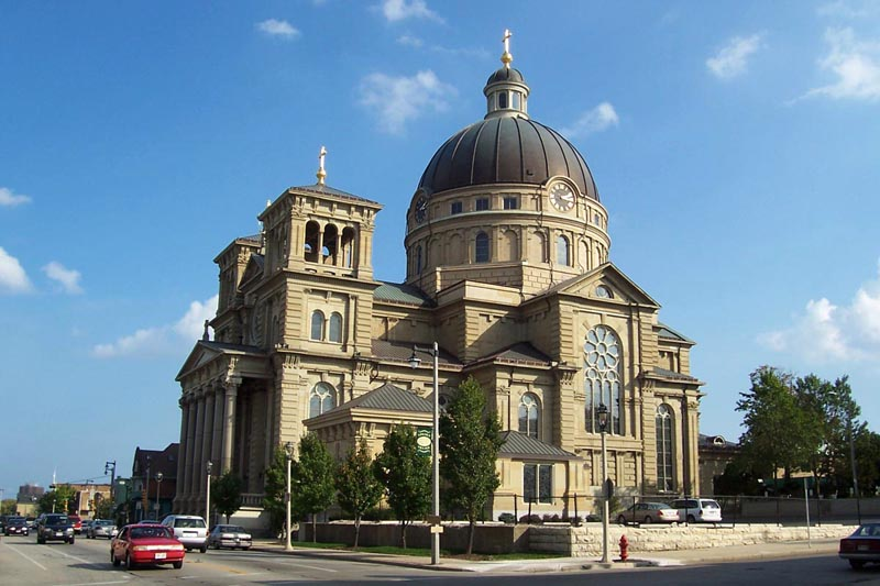 The historical Basilica of St. Josaphat, as seen from the corner of Kosciuszko Park in Milwaukee, Wisconsin. Source: Wikimedia