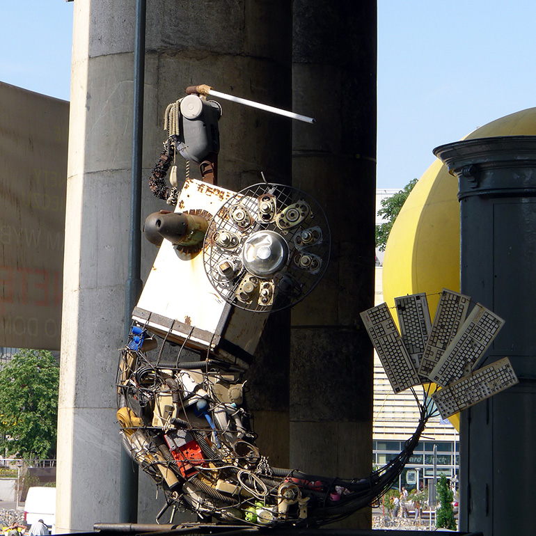 Mermaid in front of Museum of Technology, made of used electric parts and devices, 2011, photo by Dawid Lasociński / Forum