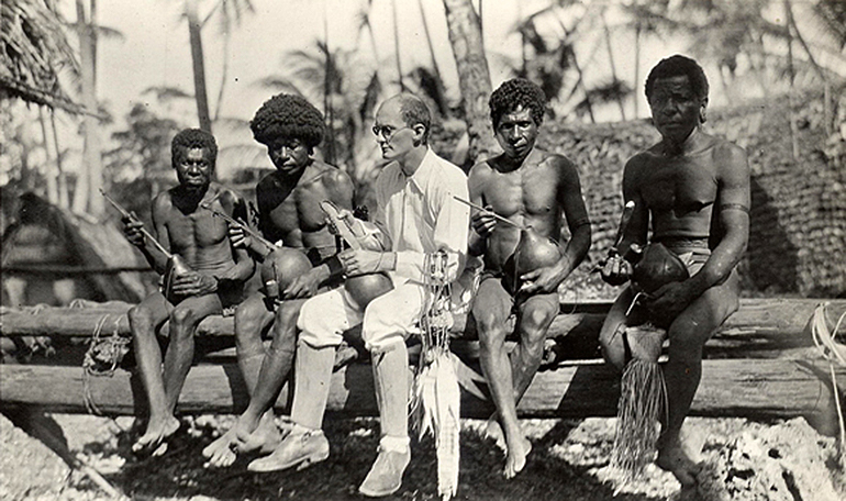Picture of Bronislaw Malinowski with natives on Trobriand Islands in 1918, photo from public domain / Wikimedia
