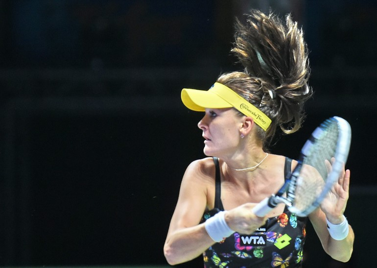 Agnieszka Radwanska of Poland plays against Simona Halep of Romania during the semifinals of the Women's Tennis Association (WTA) Finals in Singapore on October 25, 2014, photo: AFP PHOTO / Roslan Rahman / East News
