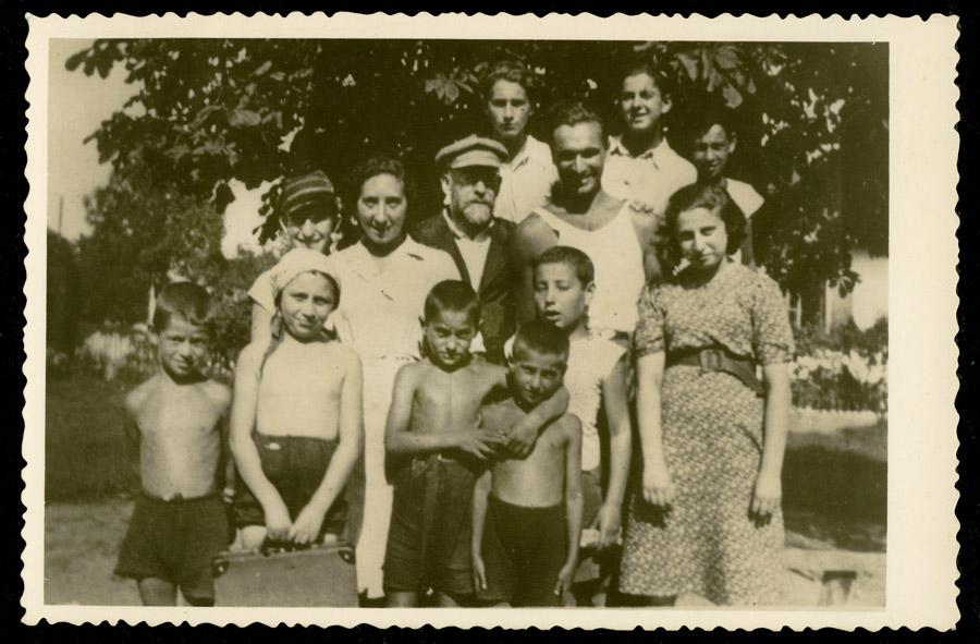 Janusz Korczak with his pupils and employees of the Orphans' Home at the DS Różyczka summer camp, Wawer (nowadays Marysin Wawerski), 1938; original prints can be found in Israel at the Ghetto Fighters' House, photo courtesy of the Korczakianum Centre for Documentation and Research in Warsaw