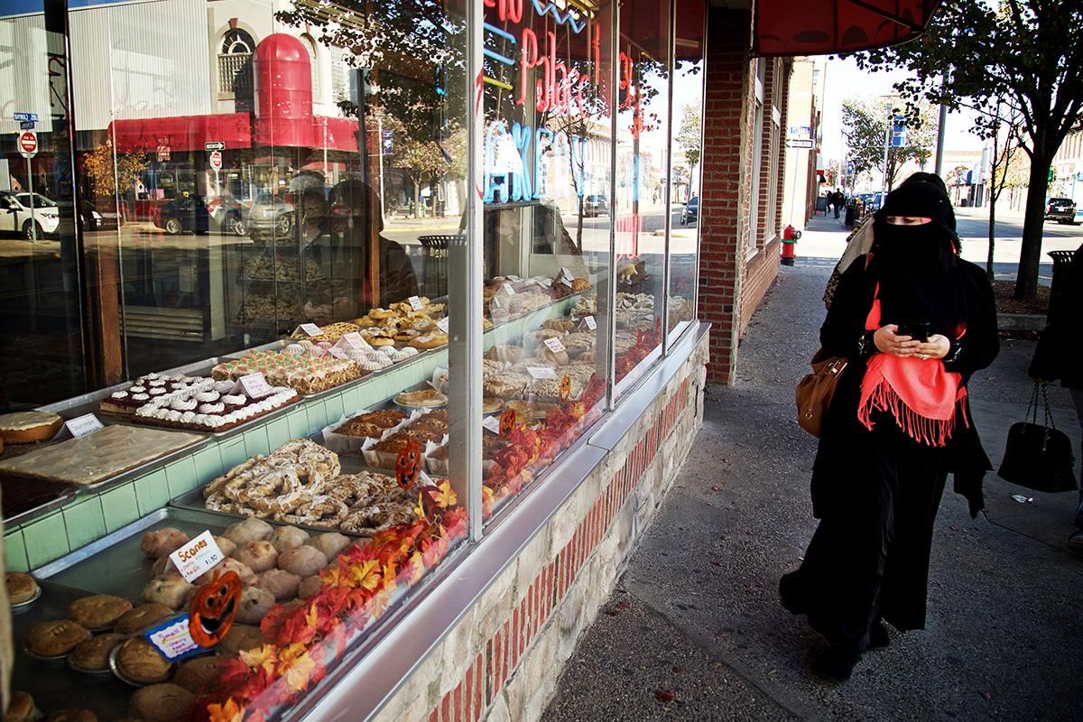 A woman looks at a pastry display while walking past New Palace Bakery on 9th November 2015 in downtown Hamtramck, Michigan; photo by Salwan Georges for The Washington Post / Getty Images