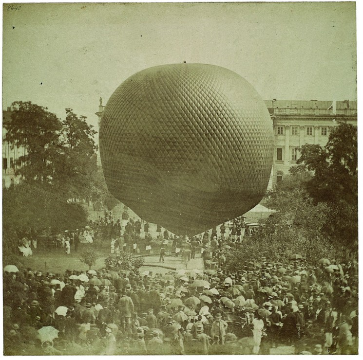 Hot air balloon take off, square in front of Kazimierz Palace, 25th August 1872. French aeronaut, Captain Brunell, invited 'all those interested in extraordinary experiences for an aerial voyage'. One of the first passengers was a journalist of Kurier Warszawski, Feliks Fryze. Photo: Konrad Brandel / National Museum in Warsaw